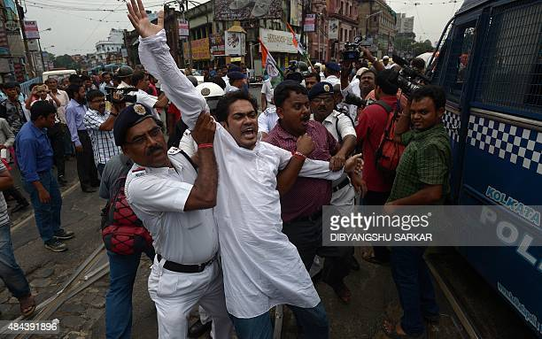Indian police detain an activist during a protest and strike by the opposition Congress party in Kolkata on August 18 2015 The Congress party has...