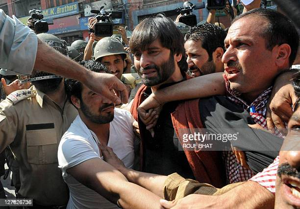 Indian police detain Jammu and Kashmir Liberation Front chairman Muhammad Yasin Malik during a protest against the death sentence on Afzal Guru in...