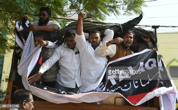 Indian police detain members of Muslim organisations as they shout slogans against the proposed 'Triple Talaq Bill' during a protest in Hyderabad on...