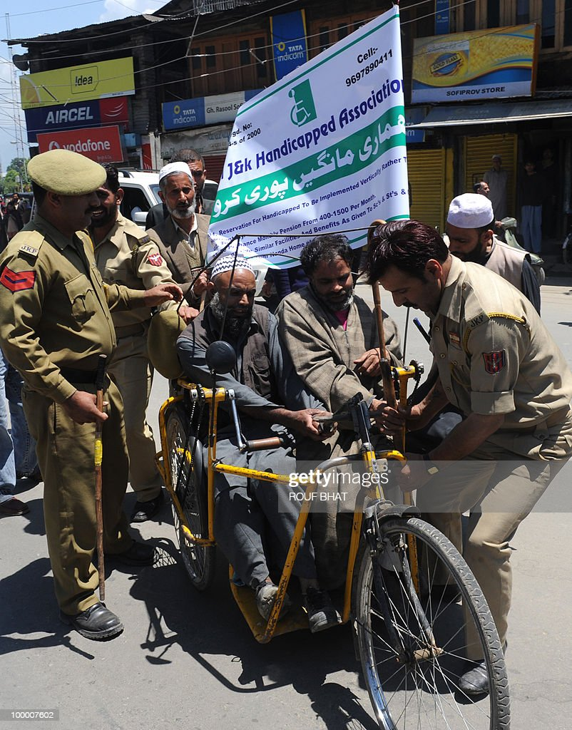 Indian police detain members of the All Jammu and Kashmir Handicapped Association (AJKHA) as they march towards the civil secretariat which houses the office of chief minister Omar Abdullah, in Srinagar on May 20,2010. The All Jammu and Kashmir Handicapped Association (AJKHA) were demanding an increase in monthly pensions and free education for deaf and blind handicapped people . AFP PHOTO/Rouf BHAT