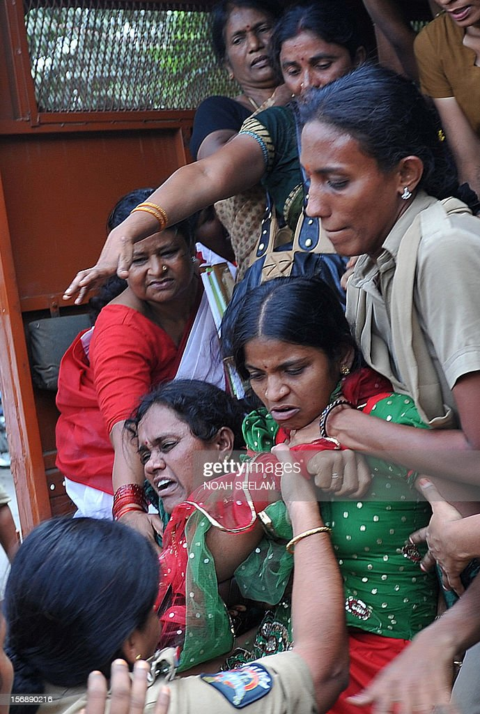 Indian police detain members of the National Federation of Indian Women (NFIW) during a protest against the increasing violence against women in the country in Hyderabad on November 24, 2012. NFIW demands action against the recent rise of violence and oppression against women. AFP PHOTO / Noah SEELAM