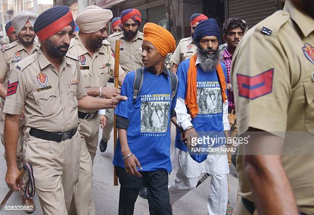 Indian police detain Sikh activists who were distributing and wearing T-shirts depicting controversial Sikh leader Sant Jarnail Singh Bhindranwale,...