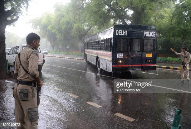 Indian police escort a police bus carrying arrested All Parties Hurriyat Conference leaders in New Delhi on July 25 2017 Separatists have called for...
