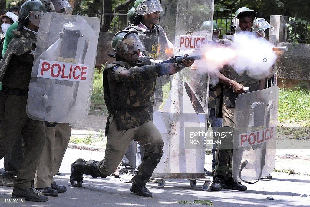 Indian police fire tear gas at members of the Telangana