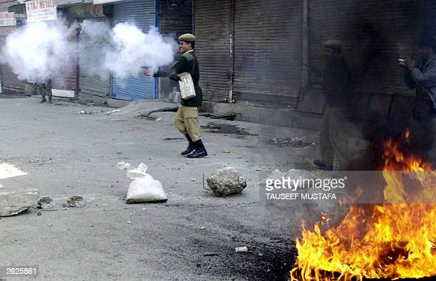 Indian police fire teargas 22 October 2003 during a protest against the arrest of influencial proindependence leader Yasin Malik in Srinagar Police...