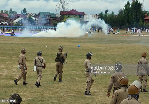 Indian police fire teargas shells towards devotees during an antiIndia protest after Eid alAdha prayer in Srinagar the summer capital of Indian...