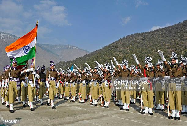 Indian police from the Jammu and Kashmir Armed Police take their oath during their passing out parade at the Sheeri training centre, some 65 km...