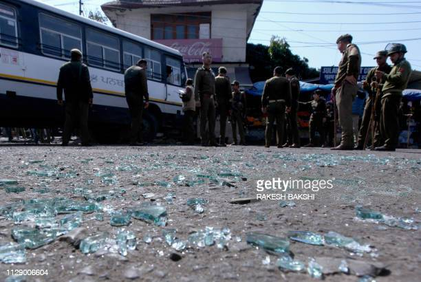 Indian police inspect the site of a grenade blast at a bus station in Jammu on March 7 2019 Eighteen people were injured on March 7 when a grenade...