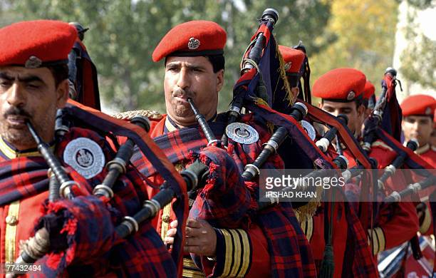 Indian police musicians play the bagpipes during an annual Police Commemoration Day ceremony at police headquarters at Zewan on the outskirts of...