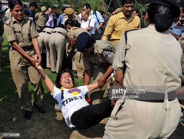 Indian police officers detain Members of the Tibetan Youth Congress during a protest on the eve of G20 summit in France outside the Chinese Embassy...
