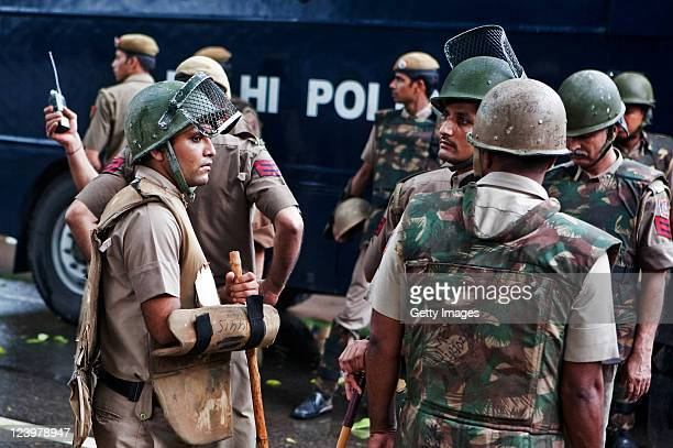 Indian police officers guard the scene of a bomb blast outside Delhi's High Court on September 7 2011 in Delhi India According to reports 10 people...