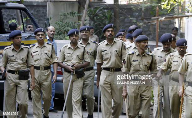 Indian police officers stand guard inside Mumbai police headquarters where the only surviving Mumbai terror attacker Mohammed Ajmal Amir Iman is...
