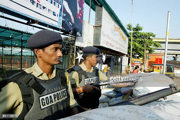 Indian police officers stand guard on a street in the capital of the Indian state of Goa Panaji on December 23 2008 Police in te Indian state of Goa...