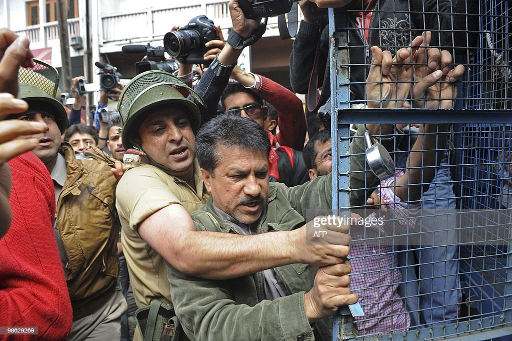 Indian police officials attempt to arrest Jammu and Kashmir Liberation Front (JKLF) activists during a protest in Srinagar on April 23, 2010. Police detained activists including the chairman of Jammu and Kashmir Liberation Front (JKLF) Yasin Malik during a protest against death sentences handed to three members of a Kashmiri group that bombed a New Delhi market in 1996. Life in Indian Kashmir was crippled by a one-day strike to protest the death sentences. On April 13, one person was killed and 24 hurt during a strike called to protest the initial convictions for the bombing, which left 13 dead and dozens injured in New Delhi's Lajpat Nagar shopping area. Anti-India insurgents have waged a two-decade fight against rule by New Delhi in the Himalayan region that has left more than 47,000 people dead, according to the official count.Seperatists put the toll twice as high. AFP PHOTO/Tauseef MUSTAFA