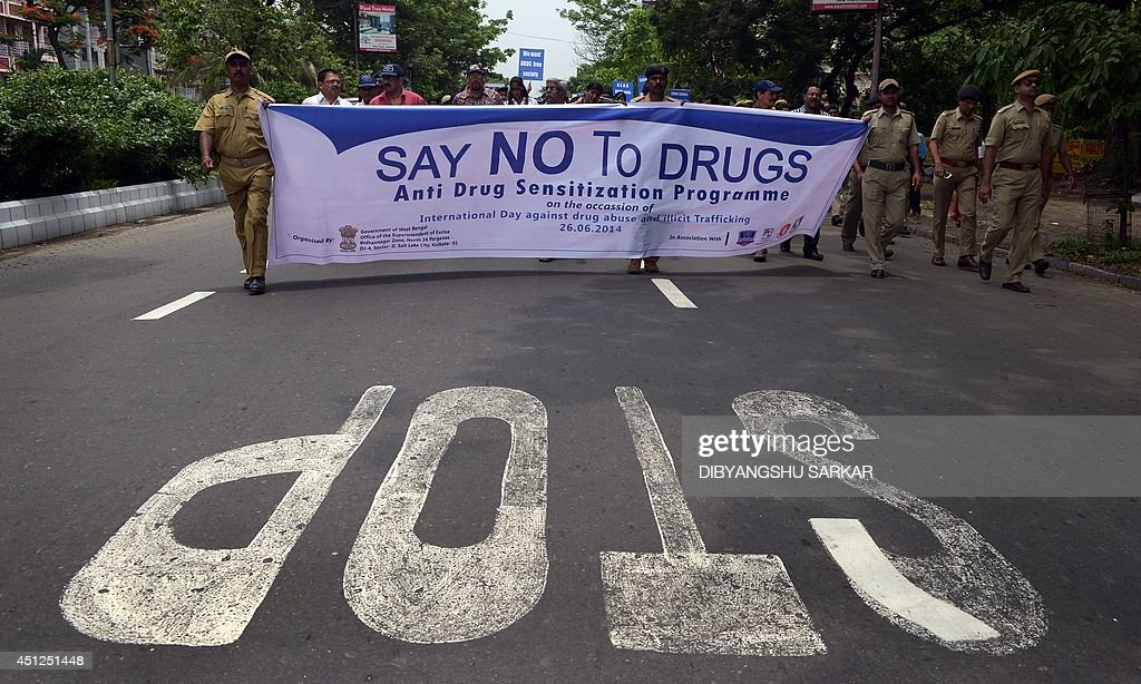 Indian police officials carry a banner during a procession
