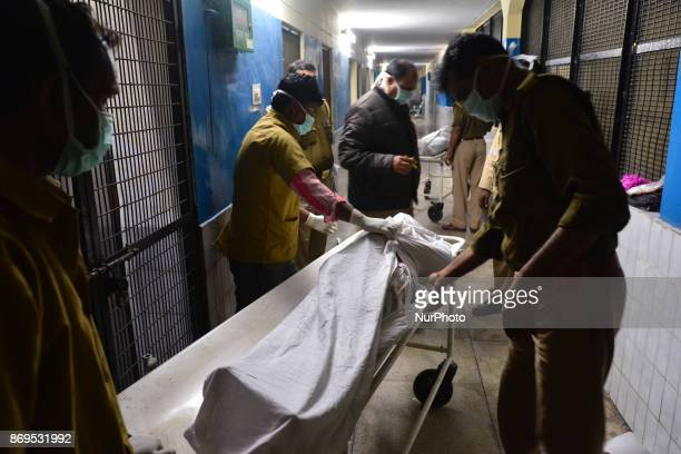 Indian police officials cover up the dead bodies of victims of NTPC boiler explode in Jeevan Jyoti hospital Unchahaar on November 2 2017 26 people...