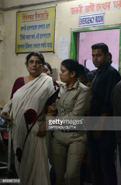 Indian police officials escort Chandana Chakraborty from a police station in Jalpaiguri on February 21 for a medical check up to a hospital in the...