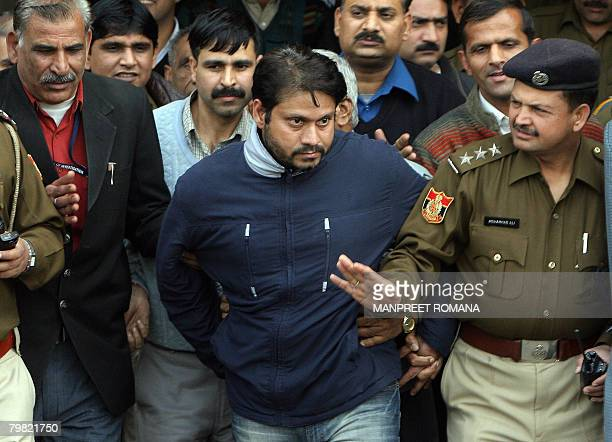Indian police officials escort Jeewan Rawat brother of accused Amit Kumar in a kidney transplant scandal after a court appearance in New Delhi on...