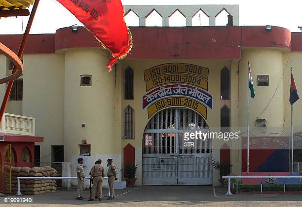 Indian police officials gather at the entrance to The Central Jail in Bhopal on November 1 a day after some inmates escaped and were killed in an...