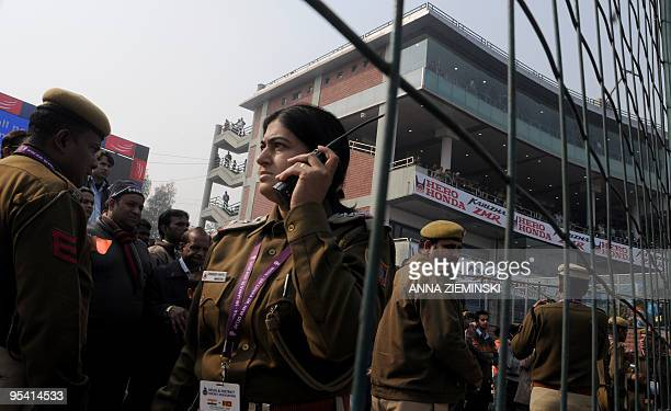 Indian police officials keep order among supporters after the cancellation of the fifth and final One Day International cricket match at The Feroz...