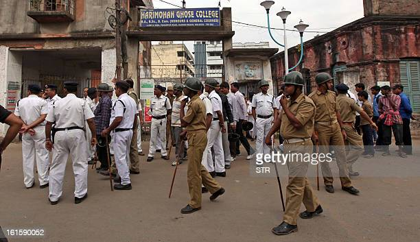 Indian police officials stand guard outside the main gate of the Harimohan Ghosh College of the Garden Reach area in Kolkata on February 12 2013 A...