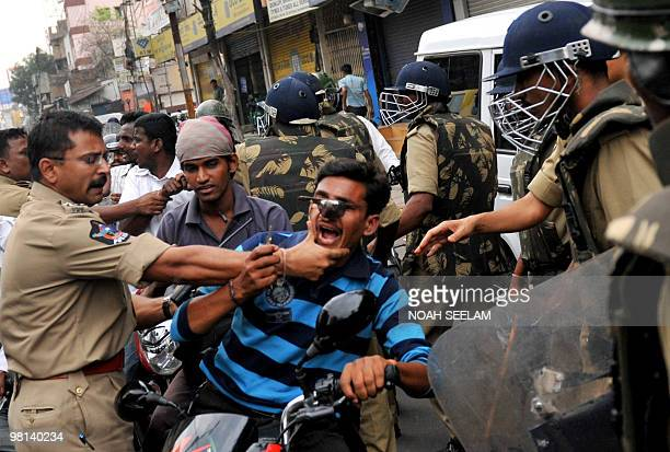 Indian police personnel arrest alledged participants in communal violence at Nalla Gutta in Hyderabad on March 30 2010 Indian police have imposed a...