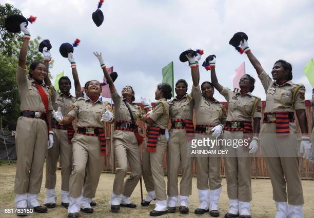 TOPSHOT Indian police personnel celebrate after a passing out ceremony at a police training academy in Agartala on May 11 2017 132 women police...
