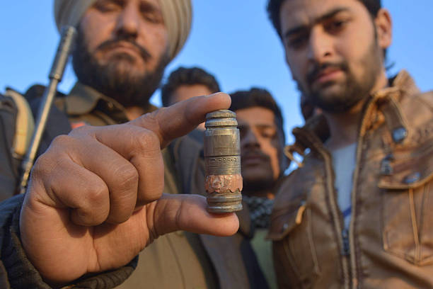 Indian police personnel display a cartridge shell near the Air Force Base in Pathankot on January 2 2016 during an ongoing attack on the base by...