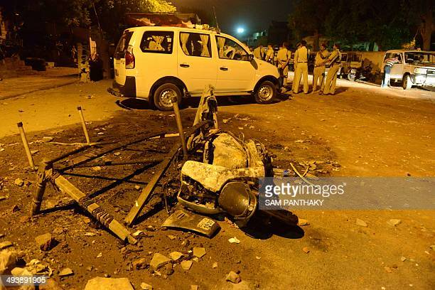Indian police secure the site of clashes between two groups during which shops and vechiles were set alight in the Gomptipur area of Ahmedabad on...