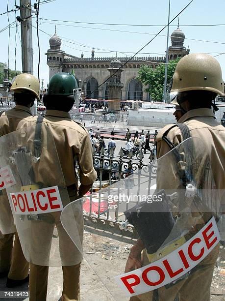 Indian police stand guard near the Mecca masjid mosque in Hyderabad 25 May 2007 following friday prayers a week after a blast at the mosque The...
