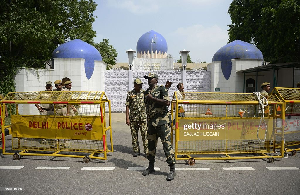 Indian police stand guard outside the Pakistan embassy in