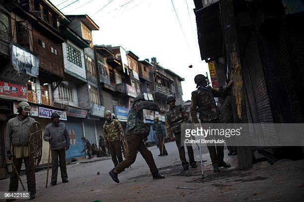 Indian police throw stones at Kashmiri protesters defying curfew during a protest on February 04 2010 in Srinagar Kashmir India Soldiers dressed in...