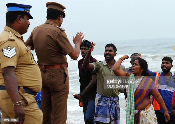 Indian police try to control a protest against the ban on the Jallikattu bull taming ritual at Marina Beach in Chennai on January 23 2017 Prime...