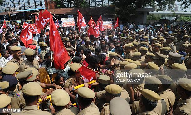 TOPSHOT Indian police try to maintain control at a protest by members of the Communist Party of India against Indian Prime Minister Narendra Modi and...