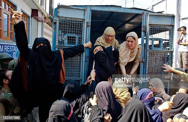 Indian police women arrest activists of DukhtaraneMillat a separatist women's group as they shout antiAmerican and antiIsraeli slogans during a...