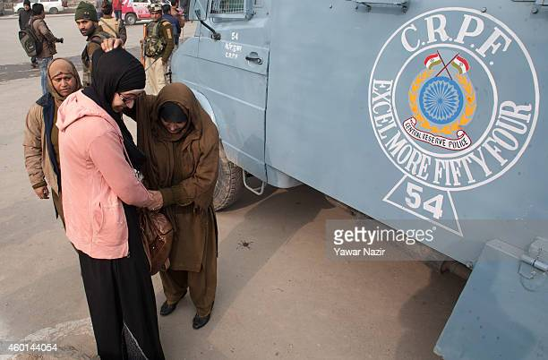 Indian police women frisk a Muslim supporter of Indian Prime Minister Narendra Modi's outside the venue where Modi is addressing his maiden election...