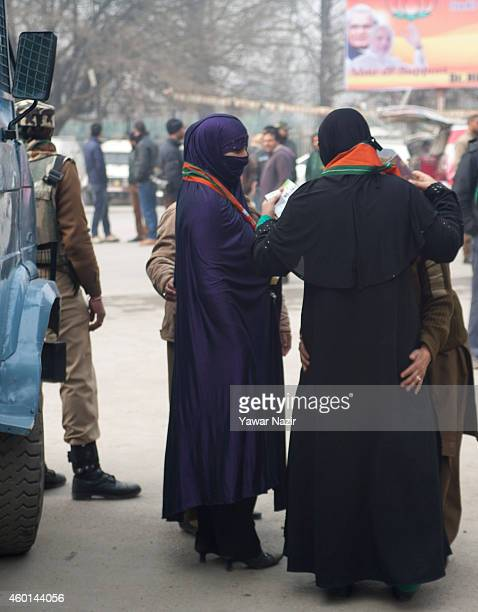 Indian police women frisk Kashmir Muslim women supporters of Indian Prime Minister Narendra Modi's outside the venue where Modi is addressing his...