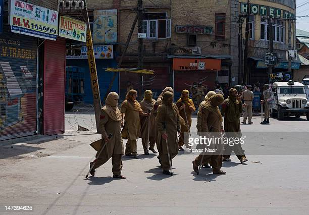 Indian police women patrol the streets during an undeclared curfew on June 29 2012 in Srinagar the summer capital of Indian administered Kashmir...