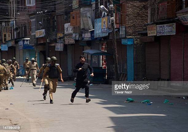 Indian policeman apprehend Hilal War a separatist leader who tried to march towards the gutted shrine of Sheikh Abdul Qadir Jilani during an...