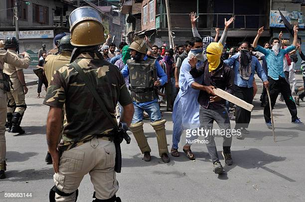 Indian Policeman chase kashmiri Muslim Protesters during clashes in Srinagar on September 2 2016 The kashmiri Muslim protesters during the funeral of...