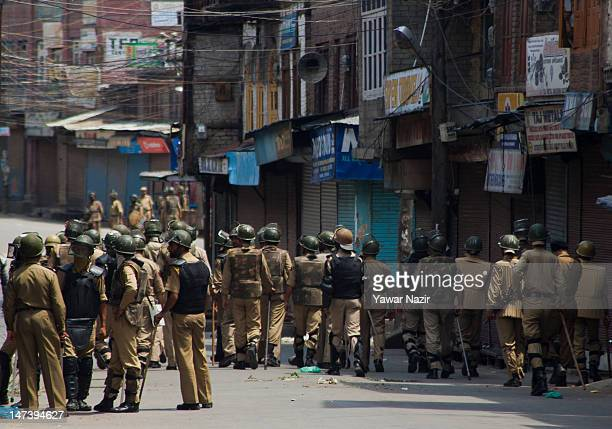 Indian policeman patrol the streets during an undeclared curfew on June 29 2012 in Srinagar the summer capital of Indian administered Kashmir India...