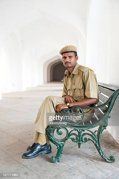 Indian Policeman relaxes on a bench at Amber Fort