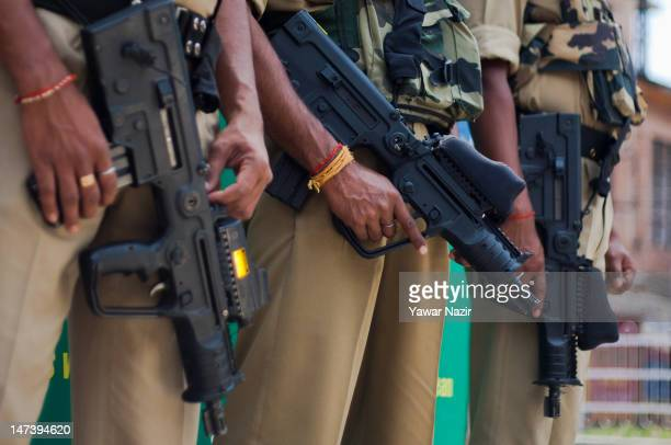 Indian policeman stand guard during an undeclared curfew on June 29 2012 in Srinagar the summer capital of Indian administered Kashmir India Life...