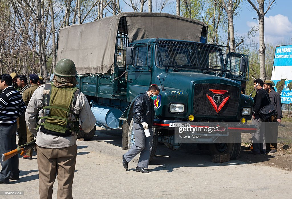 Indian policemen and paramilitary soldiers examine their vehicle after it was attacked by suspected militants this early morning on March 21, 2012 in Srinagar the summer capital of Indian administered Kashmir, India. One Indian Border Security Force (BSF) soldier was killed and two others wounded when suspected militants attacked their vehicle on a highway in the outskirts of Srinagar. The attack is the second in the last ten days after a suicide attack by militants left five Indian paramilitary soldiers dead in one of the deadliest attack's in the last five years. The Kashmir valley is on alert since the hanging of Afzal Guru, a local who was convicted of carrying out a deadly attack on the Indian Parliament attack in 2001.
