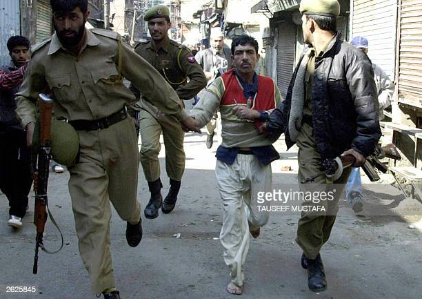 Indian policemen arrest a Kashmiri protestor 22 October 2003 during a protest against the arrest of influencial proindependence leader Yasin Malik in...