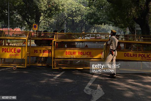 Indian policemen close a road leading towards the Israeli embassy as unseen proPalestinian protesters demonstrate against Israel during Israeli...