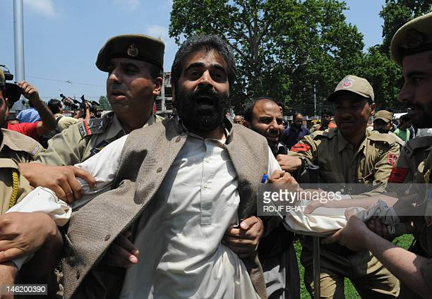 Indian policemen detain All Parties Hurriyat Conference leader Nayeem Khan during a protest in Srinagar the summer capital of Indianadministered...