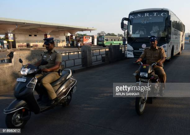 Indian policemen escort a bus leaving a terminal in Chennai on February 16 2018 India suffers severe water shortages that cause frequent tensions...