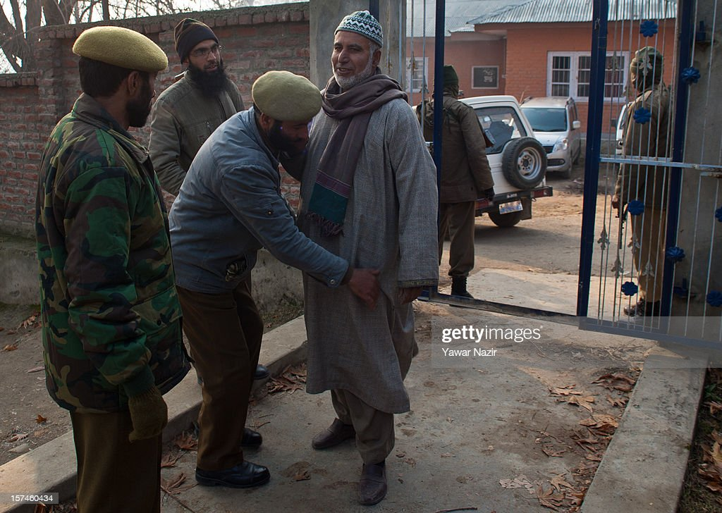 Indian policemen frisks Kashmiri Muslim village head before entering a polling station during state's legislative council election on December 03, 2012 in Budgam, west of Srinagar, Indian Administered Kashmir. Village heads in Indian-administered Kashmir voted for their representatives in the state's legislative council after 38 years today. These grass root workers are represented by four people in the council- the lower house of Kashmir assembly. This year the village heads were attacked by unidentified gunmen in the conflict torn region. Many resigned from their post after at least 10 village heads were killed in attacks. Today's polling saw long queues despite the resistance leadership calling for a boycott. But the biggest militant group in the region- the Hizbul Mujahideen- had refrained from calling a boycott saying the polling was necessary for daily administration of the state.