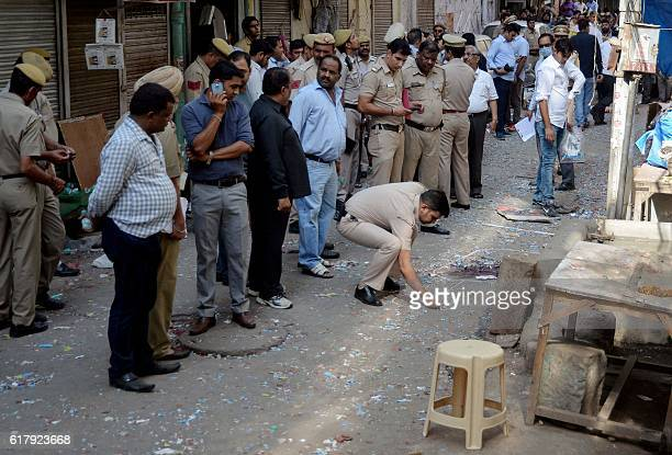 Indian policemen gather to investigate an explosion that killed one person in the old quarters of New Delhi on October 25 2016 The ultimate cause of...